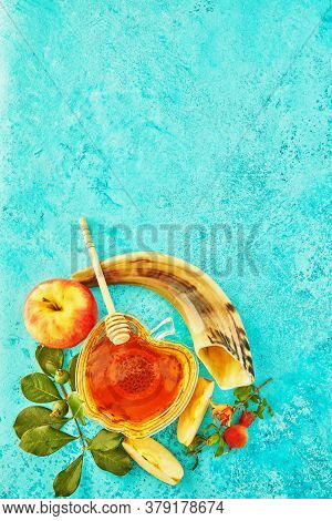 Rosh Hashanah - Jewish New Year Holiday Concept. A Bowl In The Shape Of An Apple With Honey, Pomegra