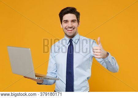 Cheerful Young Business Man In Classic Blue Shirt Tie Posing Isolated On Yellow Background. Achievem