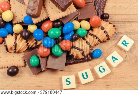 Granulated Natural Brown Cane Sugar And Candies With Cookies. Unhealthy Food And Too Many Sweets Con