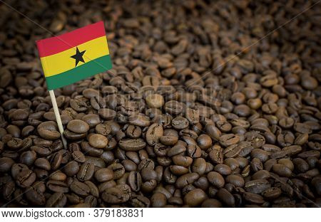 Ghana Flag Sticking In Roasted Coffee Beans. The Concept Of Export And Import Of Coffee