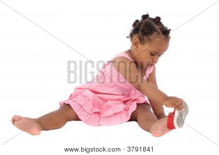 Beautiful African Baby Girl Putting On An Slipper