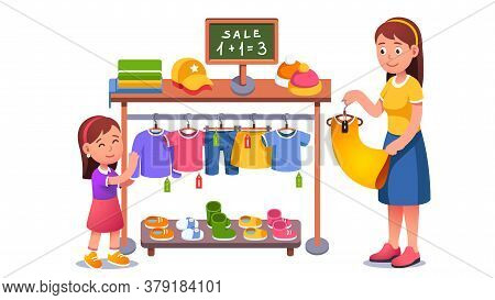 Mother And Daughter Kid Choosing Clothes At Sale