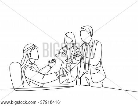 One Continuous Line Drawing Of Young Muslim Manager Handshake To Congratulate New Worker. Saudi Arab