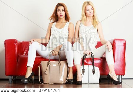 Fashion, Clothes, Clothing Accessories, Trendy Outfits Concept. Two Women Wearing Light Outfit And B