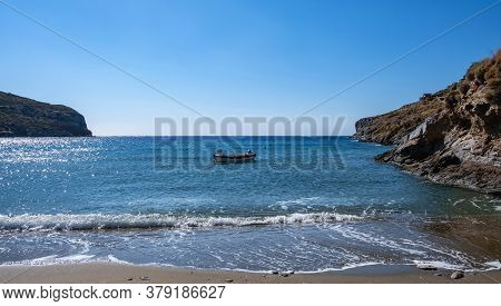Small Boat On The Sea, Blue Clear Sky, Calm Sea Water And Sandy Beach Background