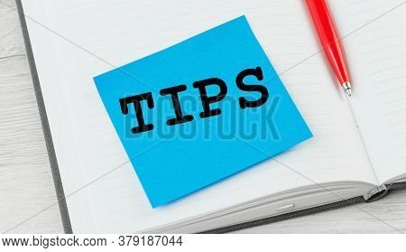Tips Word On A Notebook With Red Pen. Top Tips Or Quick Advice Concept