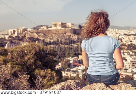 Young Woman On Background Of Urban Landscape Of Athens, Greece, Europe. Adult Pretty Girl Tourist Re