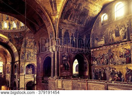 Venice, Italy - May 21, 2017: Golden Wall Mosaic Inside St Mark`s Basilica Or San Marco. St Mark`s C