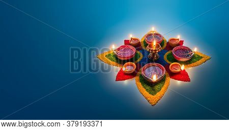 Happy Diwali, Diya Lamps Lit On Colorful Rangoli
