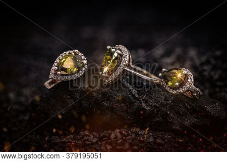 Stylish Jewelry. Ring And Earring With Gems On Carbon Background