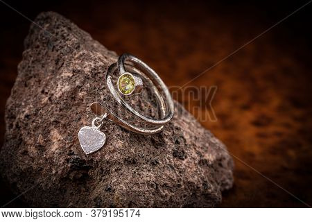 Spiral Silver Ring With Yellow Crystal On The Rock