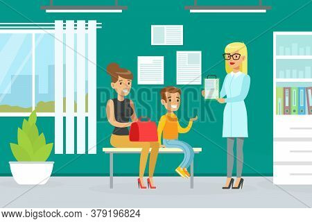 Mother And Son Visiting Doctor Together For Checkup At Pediatrician Office, Doctor Woman Doing Medic