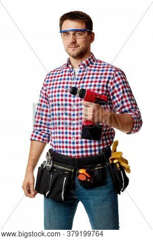 Caucasian Repairman Worker Holding Cordless Screwdriver. Handyman Wearing Tool Belt Isolated On Whit