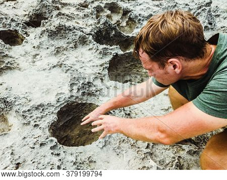 Man Pulls His Hands Into Mystic Dark Moon Crater. Astrology, Astronomy, Paranormal Activity Concept