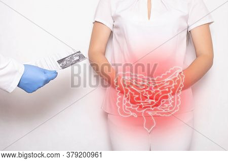 The Doctor Holds The Results Of The Examination Of The Female Patient On A White Background. Bowel I