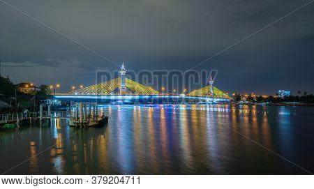 Maha Chesadabodindranusorn Bridge Or Nonthaburi Bridge Crossing Chao Phraya River And Bangkok Skylin