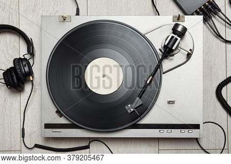 Vinyl Player With Long Play Or Lp Record And Old-fashion Headphones. Top View.