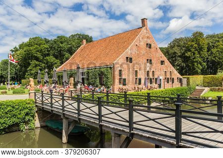Uithuizen, Netherlands - July 29, 2020: Bridge And Restaurant At The Menkemaborg Building In Groning