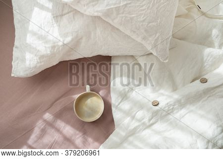 Cup Of Fresh Coffee In Bed, Morning Mood. Linen Cotton Textile Bedclothes. Organic And Natural Linen