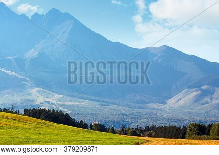 Countryside Summer Landscape. Rural Fields Rolling In To The Distant High Tatra Mountain Ridge In Sl