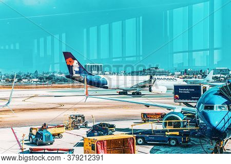 Terminal View Of Los Angeles Airport Named By Tom Bradley.view Of The Airfield With Airplanes.