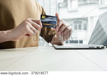 The Businessman\'s Hand Is Holding A Credit Card And Using A Laptop For Online Shopping And Internet