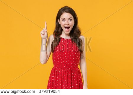 Excited Young Brunette Woman Girl In Red Summer Dress Posing Isolated On Yellow Wall Background Stud