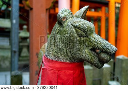 Close-up View Of Guardian Fox Stone Statue In Fushimi Inari-taisha Shinto Shrine In Kyoto, Japan. To