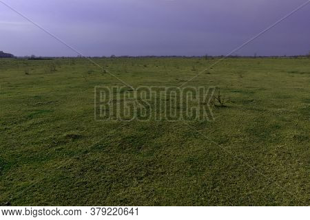 Steppe Plain On A Cold Evening. Beautiful Sky Over The Field. Landscape.