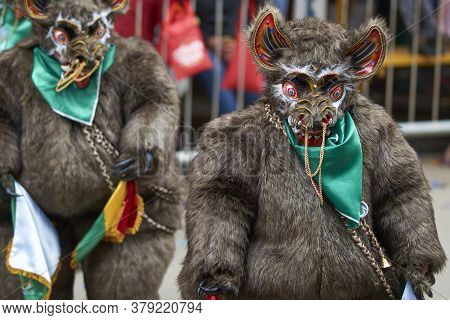 Oruro, Bolivia - February 25, 2017: Diablada Dancer In Ornate Bear Costume Parading Through The Mini