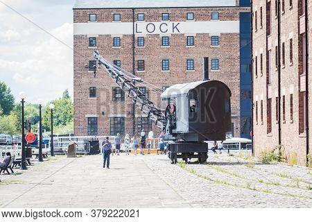 July 19 2020 Gloucester England - Railway Crane And Warehouse At Regenerated Gloucester Docks Uk