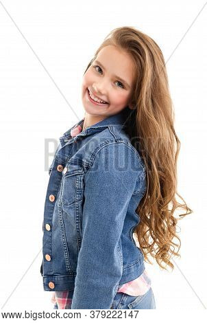 Portrait Of Adorable Smiling Little Girl Child Preteen Standing Isolated On A White Background