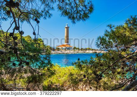 Lighthouse Of Veli Rat On The Island Of Dugi Otok, Croatia, Beautiful Seascape And Pine Trees In For