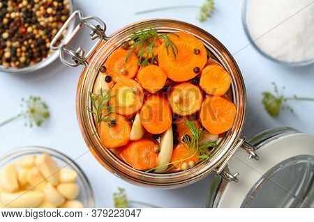 Healthy Vegan Food. Homemade Fermented Carrots With Garlic, Dill And Pepper In A Glass Jar. Light Bl