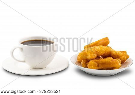 Breakfast With Hot Black Coffee In White Ceramic Cup And A Pile Of Deep-fried Dough Stick In White C