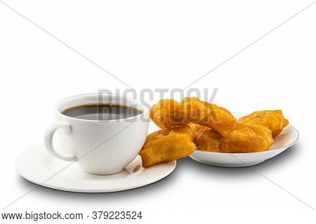 Black Coffee In A White Ceramic Cup And Deep-fried Dough Stick In A White Ceramic Plate On White Bac