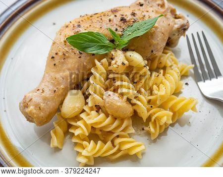 Garlic Butter Chicken With Pasta Main Ingredient Garlic,butter,chicken,pasta Is Placed On A White Pl