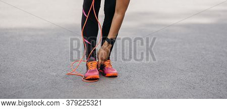 Cardio Training And Athletics. African American Woman In Sportswear With Fitness Tracker Straightens