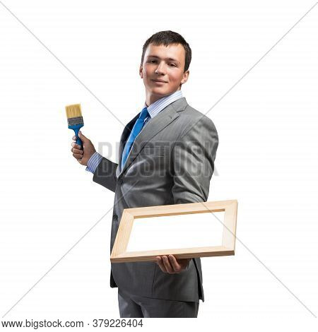 Creative Businessman Painter Holding Paint Brush And Whiteboard In Hands. Portrait Of Happy Handsome