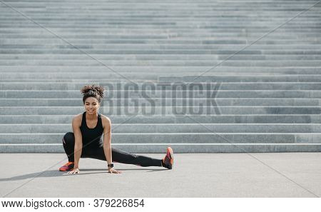 Affordable Sport Outdoor. Smiling African American Woman In Sportswear With Fitness Tracker And Wire