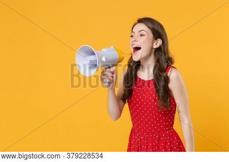 Cheerful Young Brunette Woman Girl In Red Summer Dress Posing Isolated On Yellow Wall Background Stu