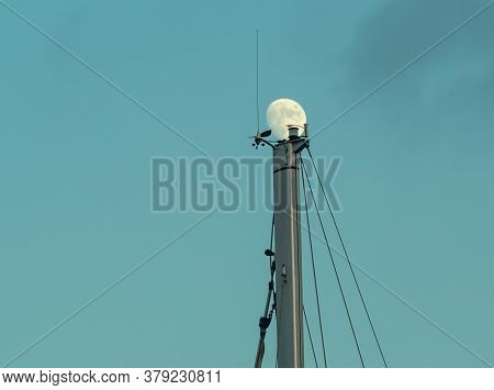 The Moon On The Tip Of The Mast Against  Night Sky