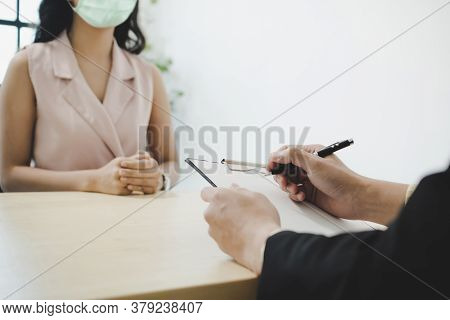 Businessman Manager And Woman Wearing Protection Face During Job Interview And Explaining About His