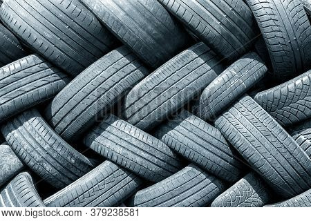 Old Used Weared Car And Truck Wheels Tyres Pile Stacked In Rows Stored For Recycling. Heap Of Many R