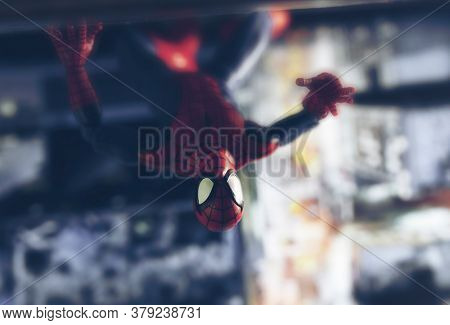 AUGUST 2 2020: Scene with Marvel comic superhero Spiderman scaling the side of a skyscraper - Hasbro Marvel Legends figure