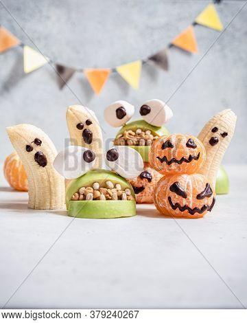 Healthy Fruit Halloween Treats. Banana Ghosts, Clementine Orange Pumpkins And Apple Monster Mounts