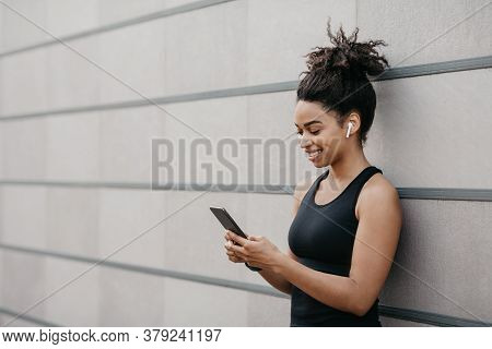 Activity Motivation, Vitality And Sport. Smiling African American Girl In Sportswear With Wireless H