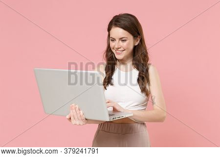 Smiling Young Brunette Woman Girl In Light Casual Clothes Posing Isolated On Pastel Pink Wall Backgr
