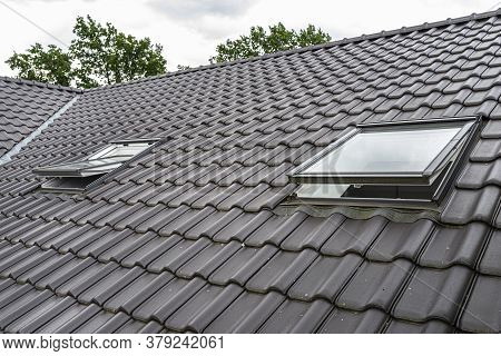 Two Open Roof Windows In The Attic, Visible Anthracite Ceramic Tiles.