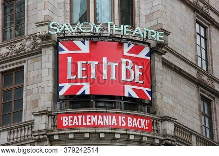 Beatlemania Is Back. Let It Be Musical Billboard, Savoy Theatre. Signboard Over Savoy Theatre Entran